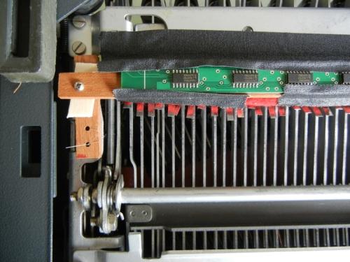 wood crossbar holds sensor strip