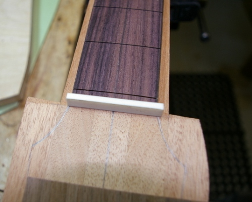 dry fitting the fingerboard, nut and head veneer