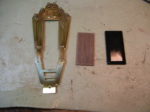Selmer style tailpiece with replacement walnut insert & original plastic one