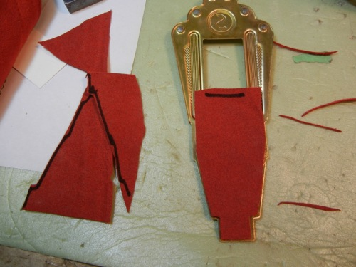 red suede leather piece glued to underside of tailpiece