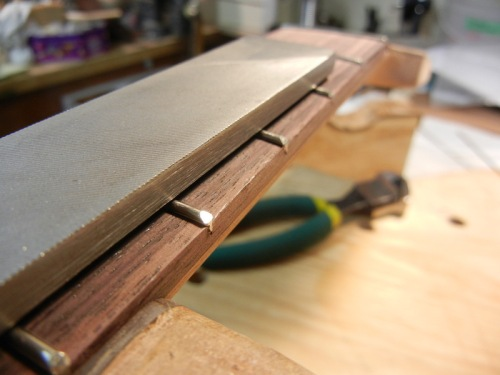 the file is used to angle the fret ends here