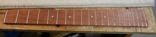 fingerboard already fretted, ready for assembly to neck