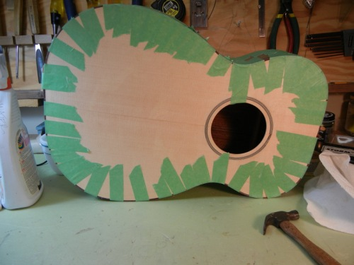 guitar with bindings glued on and taped tightly