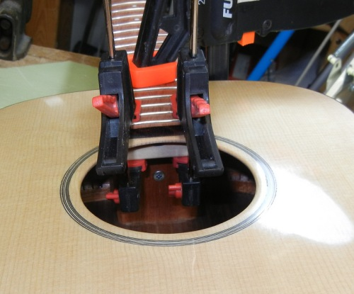 clamping the fingerboard  - the screw in the neck block pulls the neck tight to the body