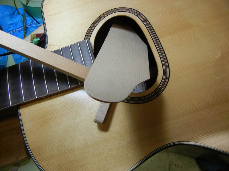 inserting the plate through the soundhole