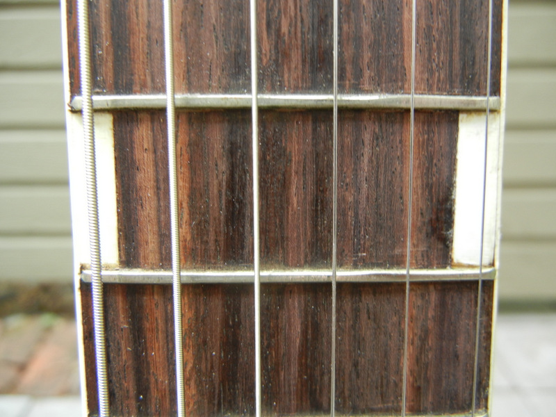 rosewood bound fingerboard, with tiny narrow frets
