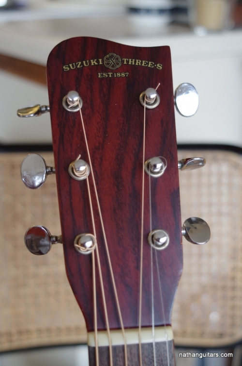 headstock logo with Suzuki Three S label