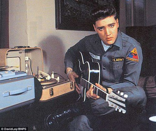 Elvis with his phonograph/amplifier